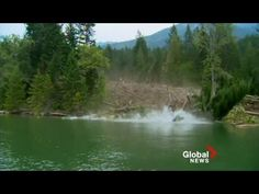 [Raw Video] Global Video - July - A truly miraculous escape in the very nick of time as a mudslide comes ripping down a hillside and destroying a boat landing.