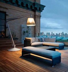 Over-sized exterior floorlamp; Dedon furniture configuration in a roof terrace location.