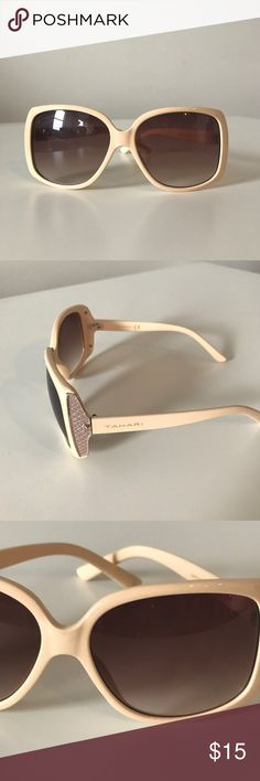 Nude Tahari Sunglasses Great color nude cream. Tahari sunglasses shades. Taupe lattice design on sides. Small very slight scratch on right lens as seen in photo. Other than that perfect condition. Tahari Accessories Glasses