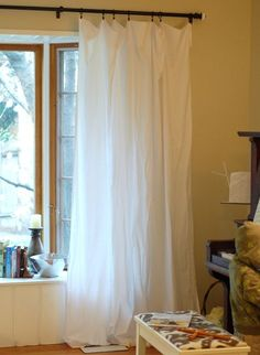 Take the Side Street: Inexpensive No-Sew Curtains. This site has a lot of DIY projects