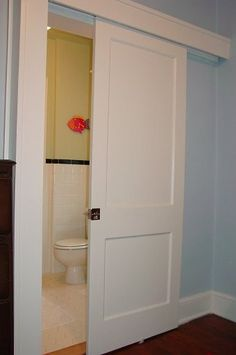 space saving door for the bathroom addition
