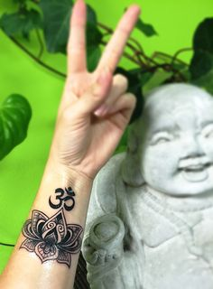 Peace and Love! Lotus mandala wrist tattoo!