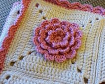 This flower square was adapted from my All In One Wrap Flower to make a nice flower square with a flat solid back and a nice 3D front. It makes a nice addition to any blanket.   - FREE CROCHET PATTERN
