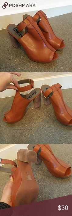 DKNY Heels for Summer! Gently worn DKNY heels. Has a little spot on the leather but not very noticeable! Very comfy shoes to wear for long periods of time. DKNY Shoes Heels