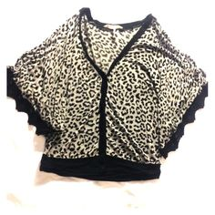 Cheetah crop Super cute with lace on the arms its a little cropped covers belly button . Make offers and bundle to save not BM just for views ✨ Brandy Melville Tops