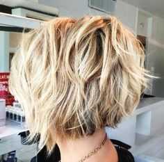 short shaggy brown blonde hairstyle. Love the back and then a few long pieces in front and side