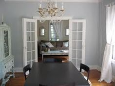 Dining room painted gray with white trim.   Love it!