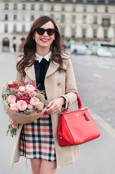 Plaid skirt and bright red Coach x Selena Gomez bag.