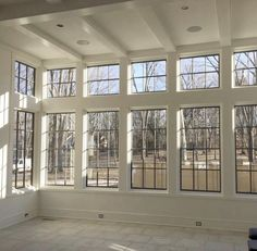 I want a room of windows! The Window Buying Guide Transom Windows, Windows And Doors, Black Windows, Sunroom Windows, Home Windows, Transom Window Treatments, Cottage Windows, Tall Windows, Ceiling Treatments