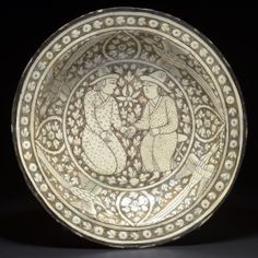 A Sultanabad plate Iran, probably Kashan, late Century Fritware covered in grey-green slip, decorated with black and white slip under transparent Ceramic Plates, Porcelain Ceramics, Ceramic Pottery, Pottery Art, Islamic Paintings, Iranian Art, China Painting, Medieval Art, Moon Art