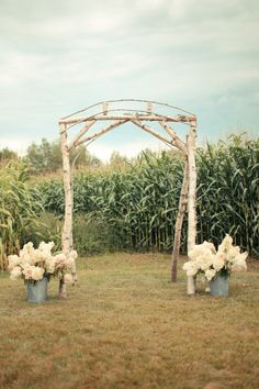 Simple, rustic arch juxtaposed with lush country-chic florals