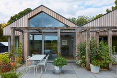 """Charlie Luxton Design decided to """"refurbish not demolish"""" a neglected brick bungalow on the edge of a village in the Cotswolds, to create a family home. Wooden Trellis, South Facing Garden, Floor Slab, Bungalow Renovation, Front Courtyard, Small Courtyards, Rural Retreats, Roof Structure, Small Buildings"""