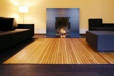 a wood mat that rolls up like a carpet :)