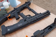 Meet the DP-12 by Standard Manufacturing. It's a double-barreled, twin magazine-fed bullpup shotgun. Think pump-action side-by-side.
