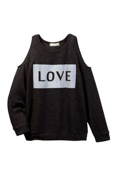"""A lightweight, stretchy sweater with cold shoulder cutouts and a glittery banner across the chest that reads, """"LOVE."""""""