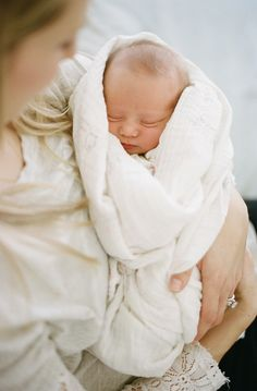 so sweet! swaddled newborn baby.