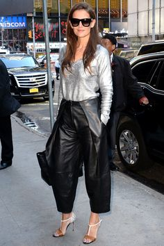 Katie Holmes in a metallic V-neck and leather culottes, both by Zac Posen | July 24, 2015