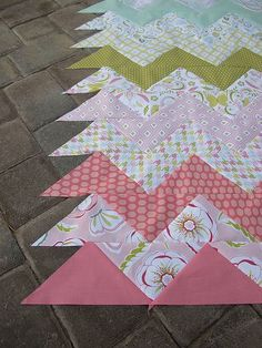 Easy way to do chevron quilt - and you can mix up fabric for a cute twist! Use triangles!: