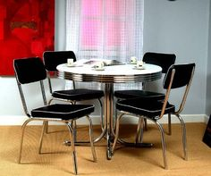 The Target Marketing Systems 5 Piece Retro Dining Set with 4 Dining Chairs and 1 Round Dining Table is a Fun Addition to the Home at an Amazing Price. Sold as a...