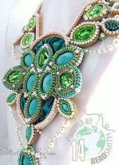 https://flic.kr/p/o8xjRo | Athena Neck piece | Created for the Battle of the Beadsmith 2014 contest. Vintage Swarovski stones, Soutache silk ribbon, Swarovski crystal pearls, bicones & 2.5mm rounds. Miyuki seed beads, RIzo beads and Chech seed beads. Copyright 2014 Melissa Ingram
