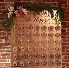Personalised: Many people on Instagram have got creative with their doughnut stations, via colourful backdrop boards and party messages (pictured)