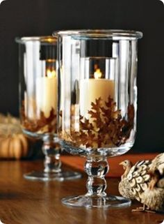 Andrea from Decorating Cents has a little thing for candles so she of course wanted to incorporate some into her fall decorating.  She headed to her local dollar store to gather some supplies. Andrea glued her glass candle holders into the vases and then added her spray painted fall leaves. So simple yet so pretty! Plus, Andrea can very easily trade out the leaves as the seasons change