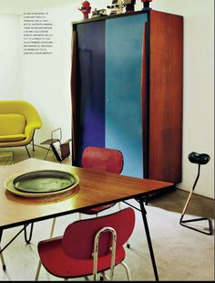 armoire with cobalt and turquoise painted doors + red and yellow chairs