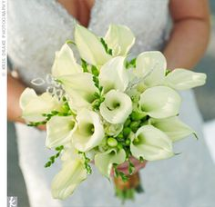 a bouquet of ivory freesias and calla lilies