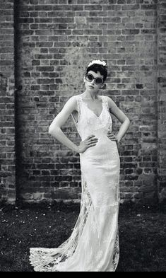 $1,440 ( Retail price $2,400) US 6.  Cool, indie brand La Poesie bridal. soft white, unworn/Unaltered sample dress in perfect condition.Designed to make each bride look and feel like a screen icon this dress is just as exquisite from behind as from the front. Vintage and boho inspired French lace gown with a slinky bias cut silk satin slip. The white lace has a hint silver. Handmade lace covered buttons complete the back. light and unstructured and a gorgeous train showcasing the lace…