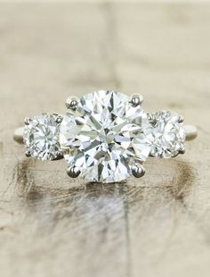 Love- side stones .......To see more gorgeous engagement rings: http://www.modwedding.com/2014/11/08/loving-untraditional-engagement-rings-like-stunners/ #wedding #weddings #engagement_rings via Ken & Dana Design