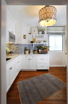 Gray and white kitchen. This could be an option. White cabinets, gray backsplash