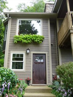 We used a rustic fiber-cement siding like this on the side of Jay's house. It looks terrific, and will last forever.