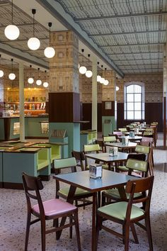 Cafe Design in Prada's art museum. Wes Anderson and designer Miuccia Prada join forces, you know the results are going to be beautiful. The director designed the fit-out for the cafe inside Prada's art museum, with various candy colours, formica furniture, decorative wallpaper and a pink terrazzo floor. Attilio Maranzano