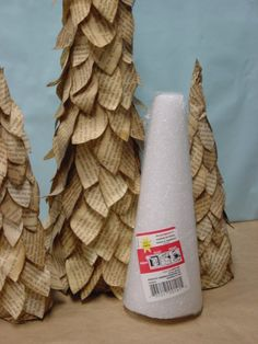 repurpose old book pages over styrofoam cones for cute trees