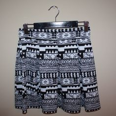 Black and White Aztec Skater Skirt NEVER WORN! Has a zipper halfway down the back. Still stretchy. So cute and goes with any solid color!!!! My Story Skirts Circle & Skater