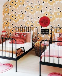 Sophisticated kids' room with vintage metal twin beds, and a printed floral wallpaper