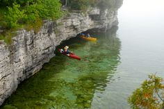 In and out of mini caves along Cave Point County Park in Sturgeon Bay, WI.  Gorgeous glass water on this kayak tour.