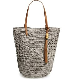 Free shipping and returns on Straw Studio Tassel Crochet Bucket Tote at Nordstrom.com. A hand-crocheted bucket bag with a slouchy silhouette features open geometric patterning and is topped by easy, over-the-shoulder handles. A studded bamboo tassel charm adds a bit of flirty movement with every step you take.