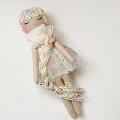 Stunningly%20original%20handmade%20doll.Mend%20by%20Ruby%20Grace%20design.%20High%20quality%20materials%20used.%20Detailed%20hand%20stitched%20rainbow%20yarn%20hair%20with%20sequins.%20Hand%20painted%20face.%20Body:%20100%%20Kona%20cotton%20fabric....