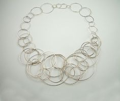 Necklace | Kate Bajic.  Hammered sterling silver rings.