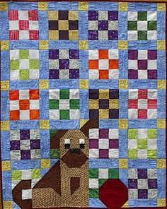Nine patch with dog and ball. (Old Made Quilts - Dog on my Quilt)