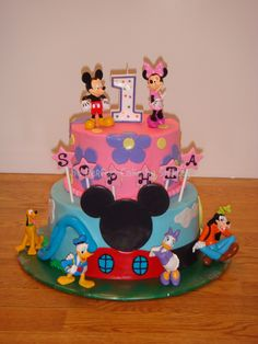 Girl Mickey Mouse Clubhouse - A girly version of a Mickey Mouse Clubhouse cake. Iced in buttercream, with fondant accents. Thanks to mbark for the inspiration!