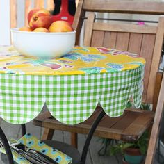 Nicole at Home: Tutorial: Round scalloped edged table cover -     This cutie made me think of you, monica @West Seattle Fabric Company Monica
