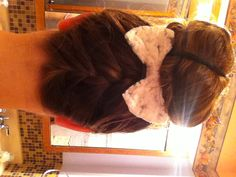 Cute reverse braid that goes into a bun. I love the bow to add a cute touch to the style