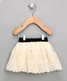 Baby eyelet skirt tutorial.  I bet I can get a super cheap table cloth at Goodwill to make this for a few dollars!