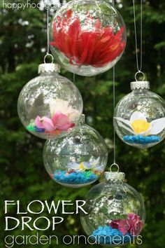 "Turn clear, plastic ornaments into gorgeous ""FLOWER DROP"" Garden Ornaments that you can hang on your patio or deck or from the branches of a tree in your yard. You could even hang them in a sunny inside!  - Happy Hooligans"