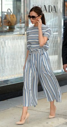 Victoria Beckham in grey and white striped culottes and top