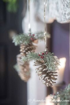 I love these gold pine cone DIY Christmas ornaments. They are so simple but still look beautiful hanging from this fireplace mantel. They could also be used for trees or for gifts. Diy Christmas Decorations Easy, Christmas Ornaments To Make, How To Make Ornaments, Handmade Christmas, Christmas Diy, Pinecone Christmas Crafts, Christmas Lanterns, Holiday Decorating, Vintage Christmas