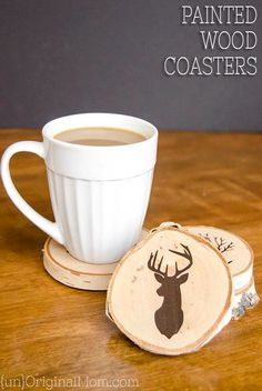DIY Painted Wood Slice Coasters - cut a vinyl stencil or buy a pre-made one from the craft store for these easy and personal handmade gifts.  (They make great gifts for guys, or any outdoor lover!)