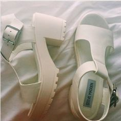 White Platform Sandals Super cute sandals, did not get much use out of them! Only a few scuffs on the platform part of the shoe! Shoes Platforms